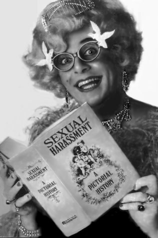 a picture of Dame Edna Everage reading literature